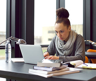 Woman working hard at her desk