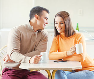 Couple Happy After Seeing A Financial Advisor
