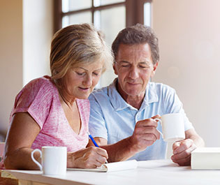 Older People Writing Notes For Financial Advisor