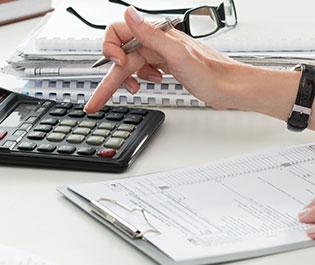 Notebooks full of Alternative Investments with Someone Calculating Risk